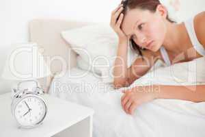 Red-haired woman waking up