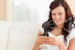 Young woman texting on mobile