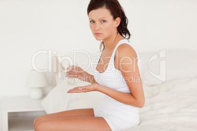Ill woman taking pills