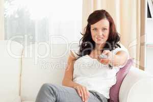 Charming woman watching TV