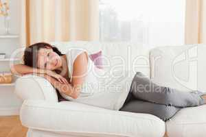 Woman relaxing on the sofa looking into the camera