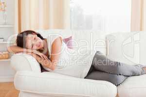 Relaxing woman lying on the sofa