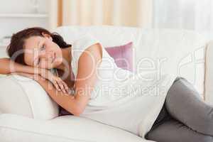 Relaxing cute woman lying on the sofa