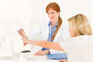 Female doctor consultation patient point computer