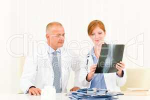 Medical doctor team male look at x-ray