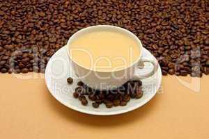 White cup of coffee and coffee beans