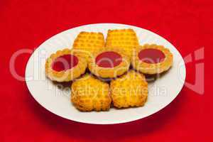 plate of cookies on red background