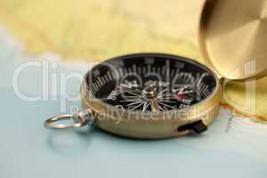 Gold compass & map
