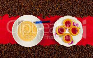coffee cup from above with coffee beans