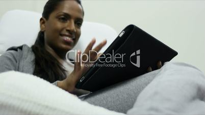 Woman using digital tablet pc at home