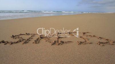 """Das Wort """"Stress"""" in den Sand geschrieben"""