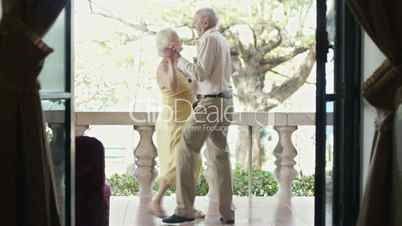 Elderly couple dancing outdoors