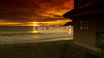 Beach house on sandy beach during beautiful sunrise