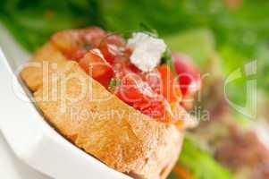 original Italian fresh bruschetta served with fresh salad and ve