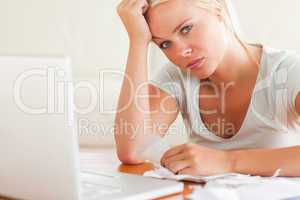 Stressed woman doing paperwork