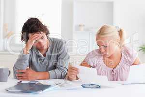 Worried couple doing paperwork