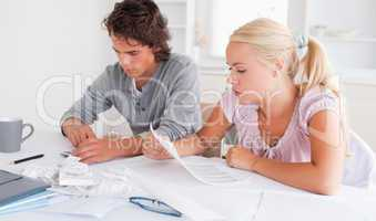 Worried cute couple accounting