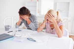Worried couple doing accounts