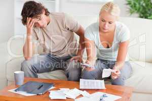 Stressed couple calculating their expenses