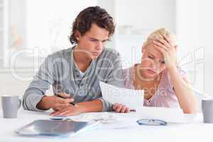 Worn out couple listing expenses
