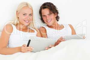 Happy couple using tablet computers