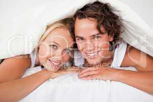 Couple under a duvet