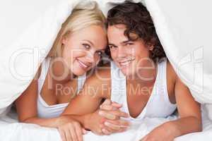 Cute couple under a duvet