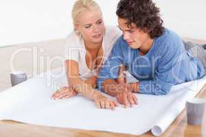 Couple talking about their future room with a plan