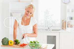 Beautiful woman slicing pepper