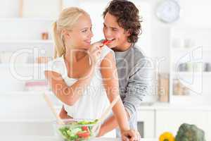Woman giving pepper to her fiance