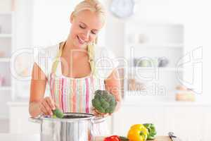Woman putting cabbage on boiling water