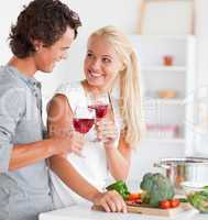 Portrait of a couple having a glass of red wine