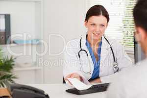 Female doctor giving patient prescription