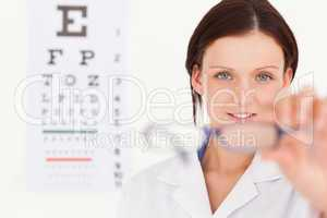 Female optician showing glasses