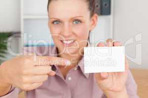 Smiling Business woman pointing at a card