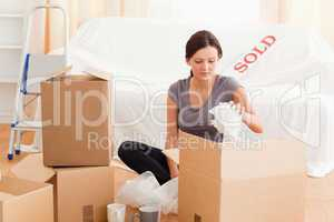 Gorgeous woman packing her property