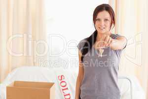 Young woman holding keys