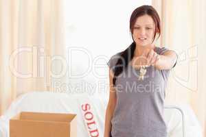 Gorgeous woman holding keys