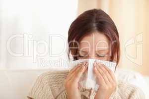 Sneezing cute woman
