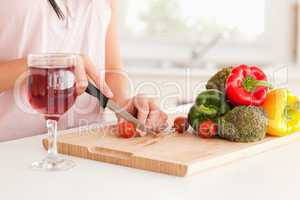 Cooking woman with a glass of wine