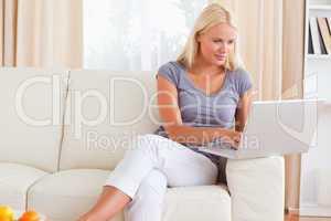 Blonde woman using a notebook