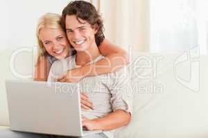 Happy couple with a notebook
