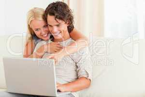 Happy couple using a notebook