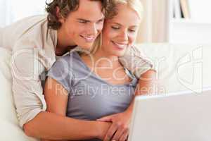 Lovely young couple using a laptop