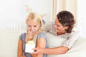 Man offering a present to his girlfriend