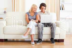 In love young couple using a laptop