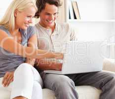 Close up of a couple using a laptop