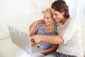 Man showing something to his wife on a notebook