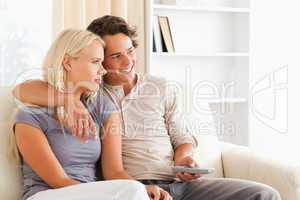 Cute couple watching TV
