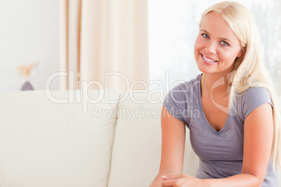Blonde woman sitting on her sofa